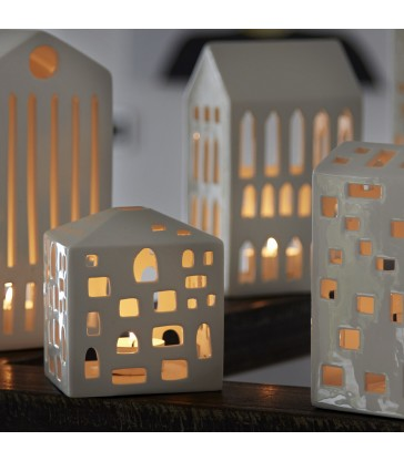 mini house tea light holder lit up with tea light inside