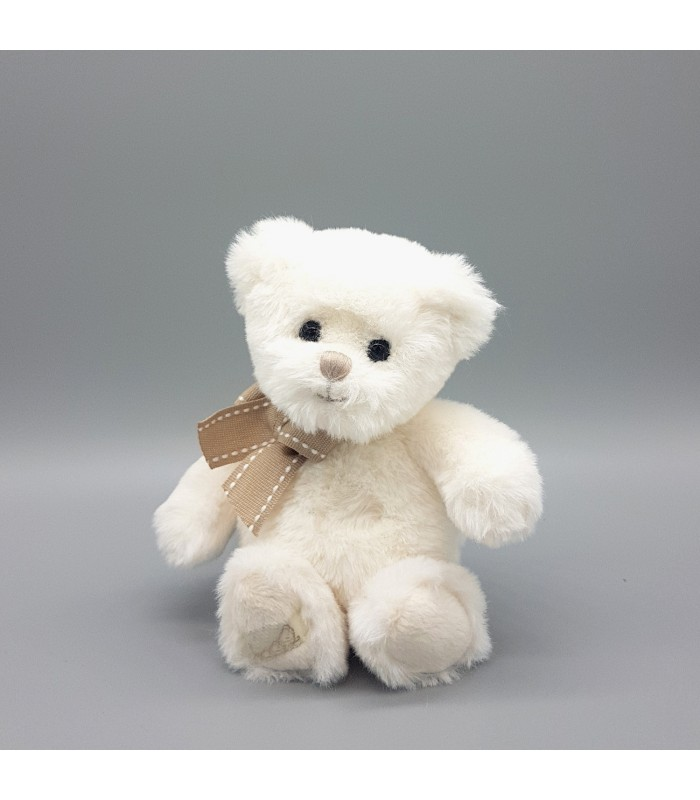 mini white teddy bear in a soft cuddly plush finish