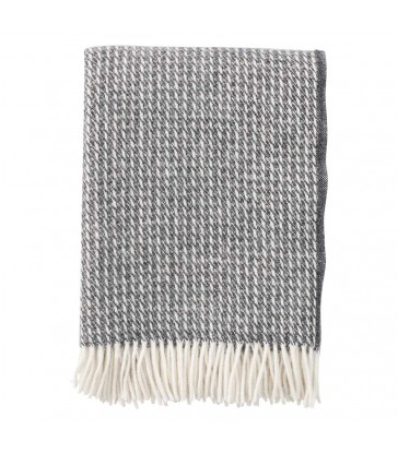 dark grey wool throw with a broken white line pattern