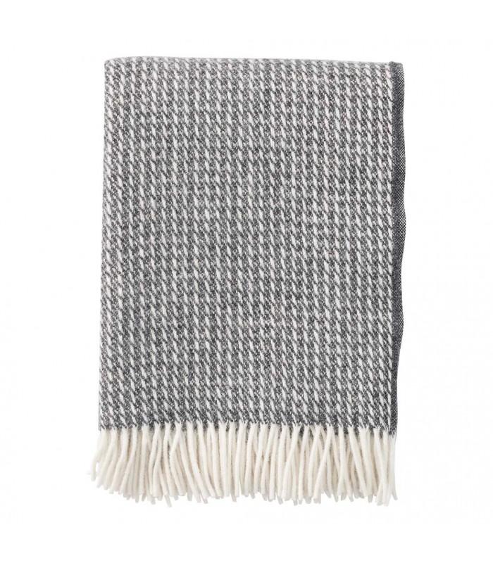 dark grey wool throw with a broken white line pattern