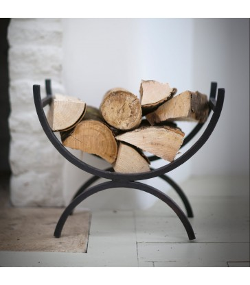 wrought iron log holder with feet and curved body