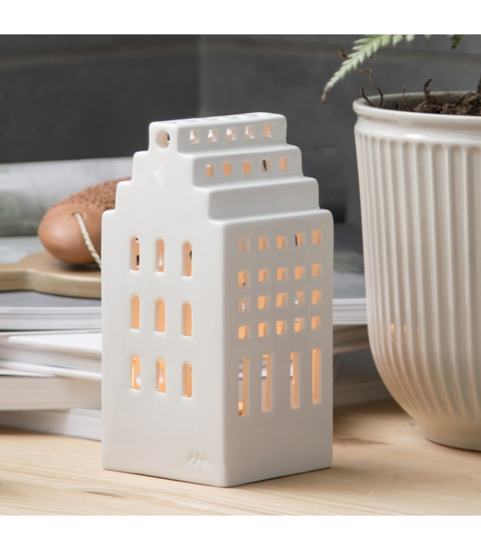 Minimalist Christmas décor for your home. This tall white tea light holder
