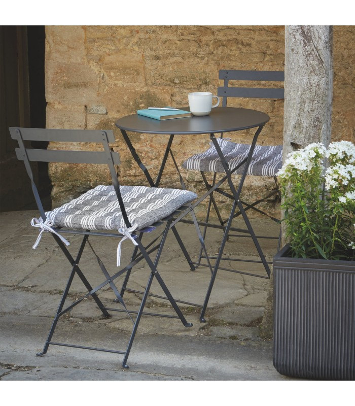 small garden table and two chairs for outdoor dining