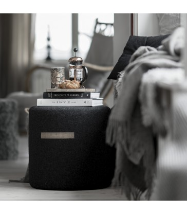 small black wool pouffe from sweden