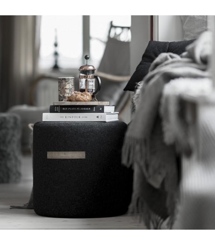 small black wool pouffe from sweden